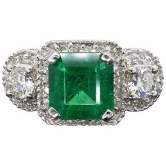 Diamond and Emerald Three-Stone Ring
