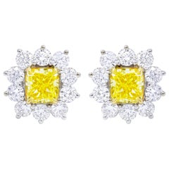 GIA Certified 3.06 Carat Fancy Yellow Diamond Stud Earrings