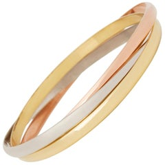 Cartier 18 Karat Yellow, White & Rose Gold Medium Trinity Bangle Bracelet