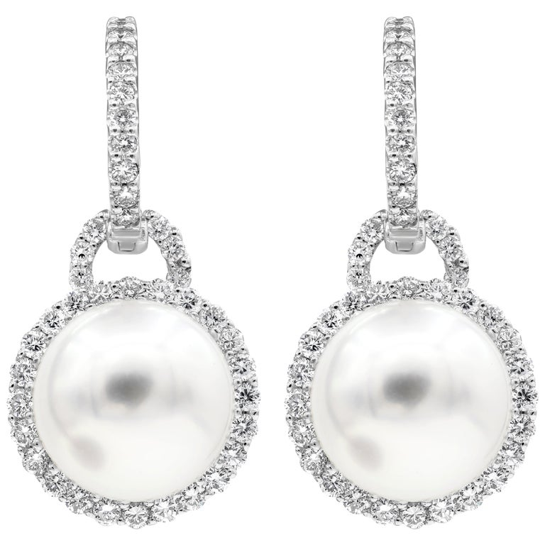 Pearl and Diamond Halo Dangle Earrings For Sale