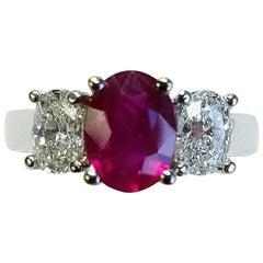 Three-Stone 18 Karat White Gold Oval Cut Ruby and Diamond Ring