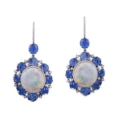 Set in 18K gold Ethiopian Opal and carved Burmese Sapphire studs/dangler earring