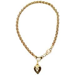 18 Karat Yellow Gold Bracelet with Heart Pendant