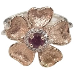 14 Karat Rose Gold Flower with a Ruby and Diamond Halo