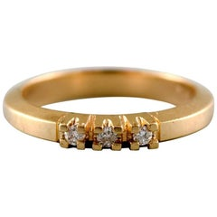 Aagaard (Denmark) ring in 14. kt. gold, adorned with three brilliant-cut diamond