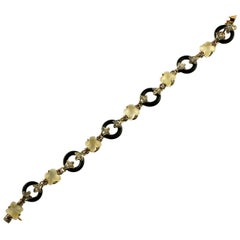 Diamonds Rubies Moonstone Flowers Onyx Rings Rose Gold and Silver Link Bracelet