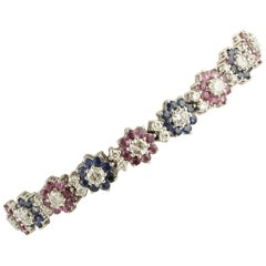 White Diamonds, Rubies, Blue Sapphires 18 Karat White Gold Flowers Link Bracelet