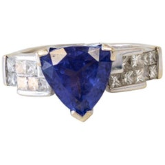 Trillion Cut Tanzanite and Princess Cut Diamonds 18 Karat White Gold Ring
