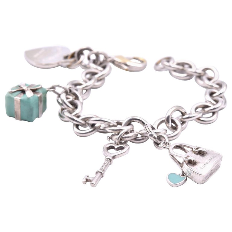 472bbe546f72 Tiffany and Co. Sterling Silver and Enamel Return to Tiffany Charm Bracelet  For Sale at 1stdibs