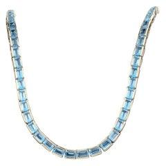 32.00 Carat Blue Topaz 14 Karat Yellow Gold Tennis Necklace