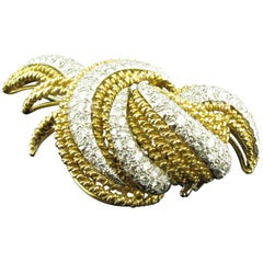 Diamond, Platinum and 18 karat yellow gold Woven Brooch