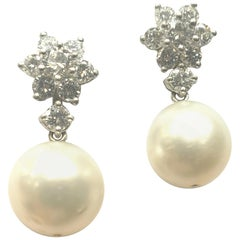 Platinum and Diamond Flower Cluster Earrings with Diamond and Pearl Jacket