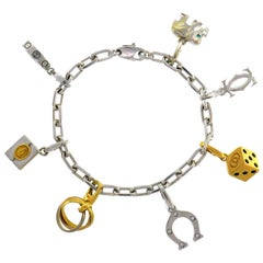 Cartier Diamond Gold Charm Bracelet with Signature Cartier Charms