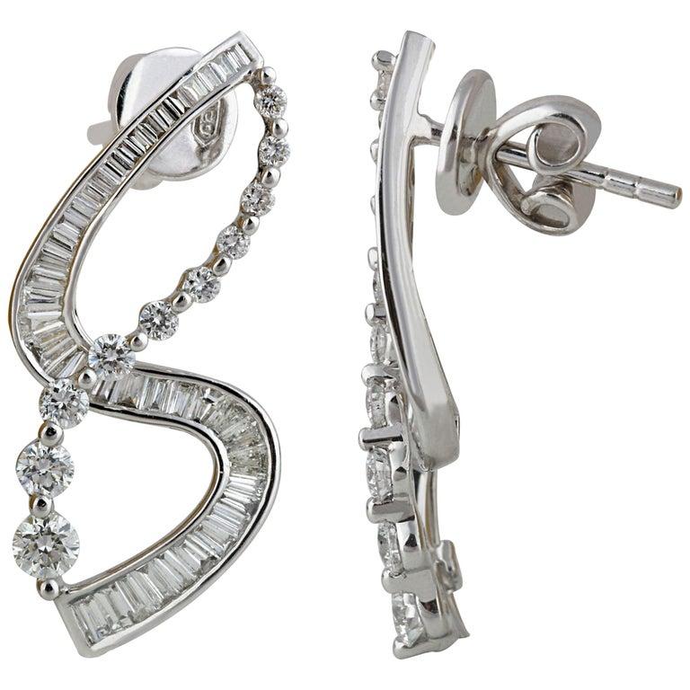 Studio Rêves S-Shaped Diamond Earrings in 18 Karat White Gold