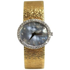 Piaget Ladies Gold Watch with Blue Gray Mother of Pearl Diamond Dial and Bezel