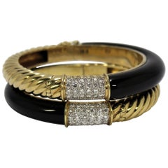 Pair of Fluted Gold, Onyx and Diamond Bangles