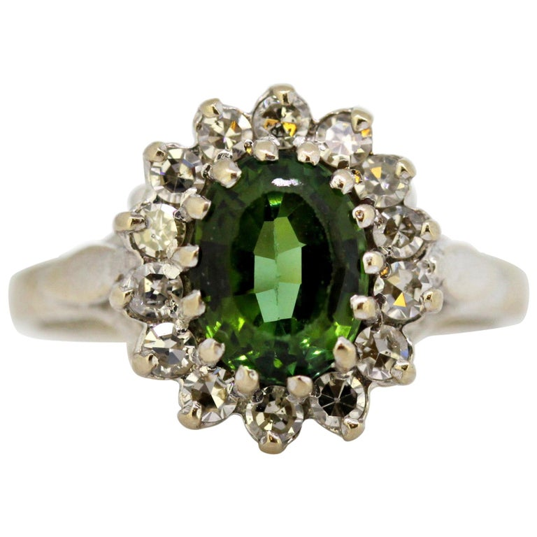 Vintage 18 Karat White Gold Ladies Ring with Green Tourmaline and Diamonds, 1977 For Sale
