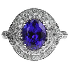 Oval Tanzanite 2.30 Carat and Diamond Fancy Cluster Ring in 18 Carat White Gold
