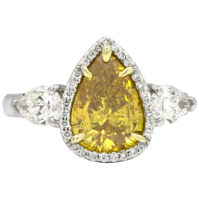 GIA Certified 2.20 Carat Vivid Yellow-Orange Pear Shape Diamond Ring For Sale