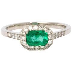 1960s Emerald Diamond Halo Platinum Ring