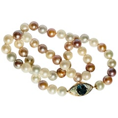 Pearls Necklace with 18K Gold, Diamonds and Topaz Eye clasp by Frederique Berman