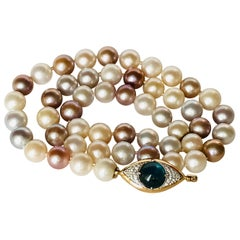 Pearls Necklace with 18 Karat Gold, Diamonds and Kyanite Eye Clasp
