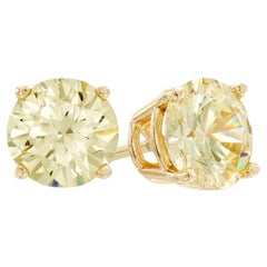 1.47 Carat Total Fancy Yellow Diamond Stud Earrings in 18 Karat Yellow Gold