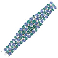 Set in 18K gold, Natural Emerald and Blue Sapphire cabochon flexible Bracelet