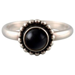 Ring in Sterling Silver by Georg Jensen, Adorned with Cabochon Cut Black Agate