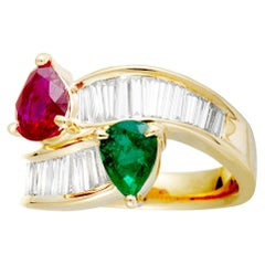 Tapered Baguette Diamonds, Emerald and Ruby Yellow Gold Bypass Ring