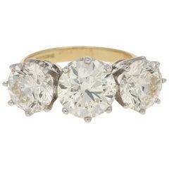 7.81 Carat Three-Stone Diamond Ring in Yellow and White Gold, circa 1996
