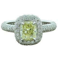Fancy Yellow Diamond White Diamond Gold Halo Engagement Ring