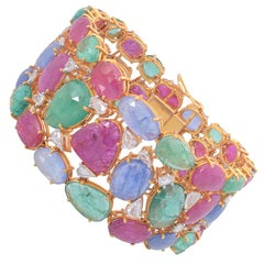 Set in 18K gold, Natural Emerald, Ruby, Sapphire & rose cut diamonds bracelet