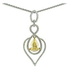 Certified 2.03 Carat Pear Shape Fancy Yellow Diamond Pendant, circa 1970
