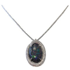 Black Opal Oval Cabochon and Diamond Pendant Necklace in 18 Karat White Gold