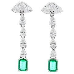 5.29 Carat Total Pear Shape Diamonds and Emerald Earrings in 14 Karat White Gold