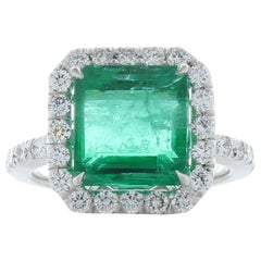 5.81 Carat Emerald Cut Emerald and Diamond Cocktail Ring in 18 Karat Gold