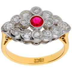 1930s 18 Carat Gold 0.25 Carat Ruby and 0.76 Carat Diamond Cluster Ring