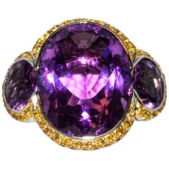 18 Karat Oval Ring Featuring Amethysts and Yellow Citrines