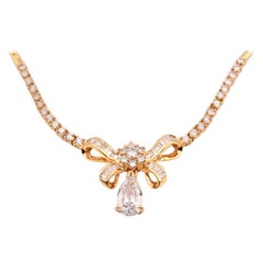 14 Karat Yellow Gold Diamond Bow Necklace with Pear Diamond Drop