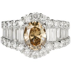 18 Karat Ring with Oval Champagne Diamond