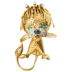 18 Karat Yellow Gold Lion Brooch with Diamonds, Emeralds and Sapphires