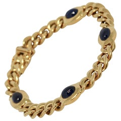 Solid 18 Karat Yellow Gold Bracelet with Four Sapphire Cabochons