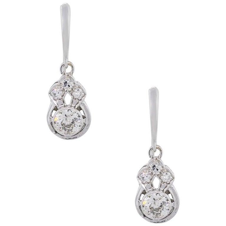 Round Brilliant Bezel Set Diamond Dangle Earrings For Sale