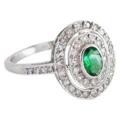 1930s Art Deco 18 Carat Oval-Cut Natural Emerald Diamond Double Halo Ring