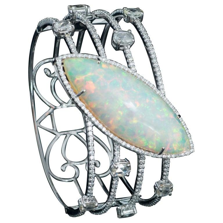 Set in 18K white gold, Marquise Ethiopian Opal & Rose Cut Diamond Cuff Bracelet For Sale