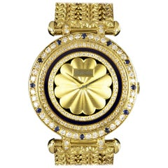 Delaneau Unworn Ladies Gold Champagne Dial Diamond and Sapphire Set Quartz Watch