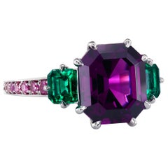 Leon Mege GIA Certified Purple Garnet with Emeralds Platinum Three-Stone Ring