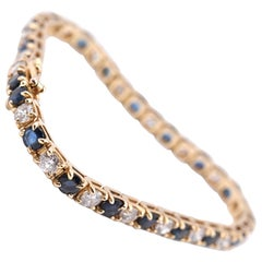 14 Karat Yellow Gold Diamond and Sapphire Tennis Bracelet