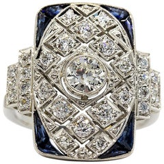 Glowing Platinum Diamonds and Sapphires Ring